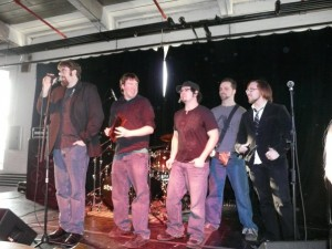 Shryne (L-R, Jon Brennan, Alex Tirrell, Jeff Cruz, Andrew Sharp, Anthony Mattera) accepting the award for Best Live Act - Indie from Limelight Magazine in January 2009. Photo by Kari Tieger.