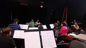 Alex leading an orchestra rehearsal for Les Miserables in October, 2014. Photo by Mary St. Laurent Sheehan.