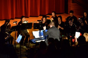 Alex leading the student orchestra of Cinderella at Exeter-West Greenwich High School in April 2011.