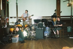 Alex in tech rehearsal with the band for the world premiere of The Clockwork Waltz - The Dresden Dolls Musical in August 2006. Photo by Kari Tieger.
