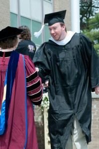 Alex at Rhode Island College Commencement, May 2010. Photo courtesy of Gene St. Pierre.